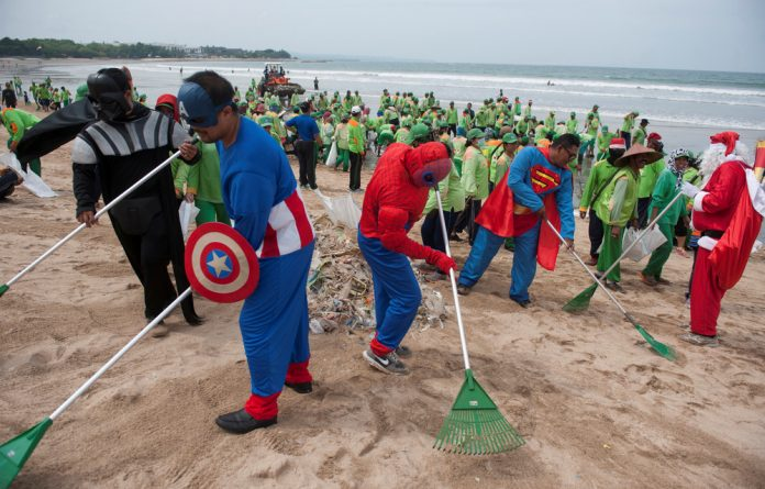 Workers wearing super hero costumes to attract tourists