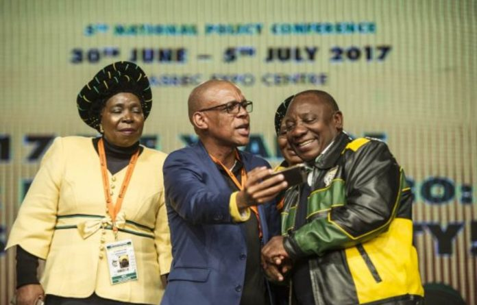 Nkosazana Dlamini-Zuma and Cyril Ramaphosa line up for a selfie at the ANC's policy conference in July.
