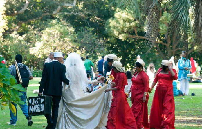 A Muslim wedding party visits Claremont Gardens in Cape Town for a photo shoot.