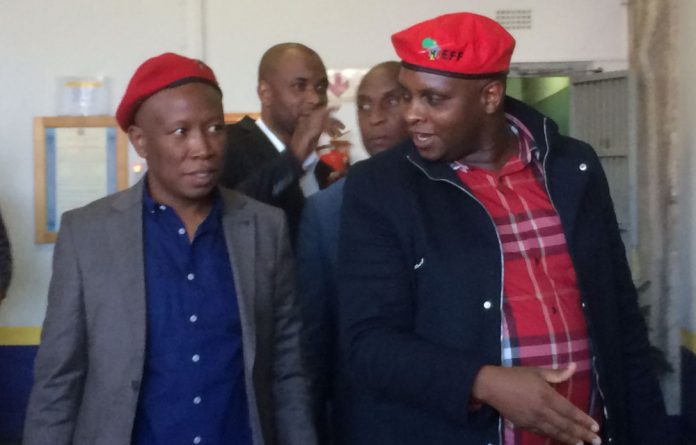Julius Malema and Floyd Shivambu exit the Johannesburg Central Police Station.