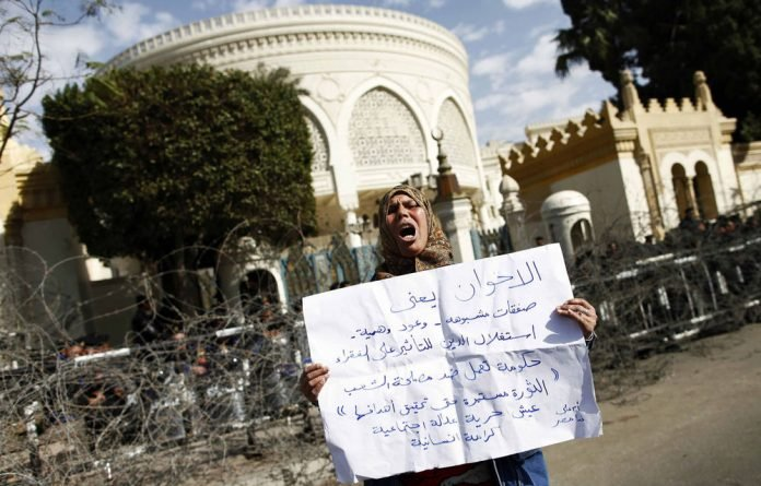 Clashes between stone-throwing youths and the police continued in streets near Cairo's Tahrir Square.