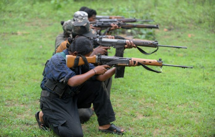 Maoists ready their weapons as they take part in a training camp in a forested area of Bijapur District in the central Indian state of Chhattisgarh on July 8 2012.