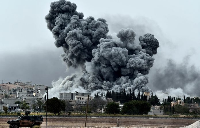 Line of fire: Smoke rises from the Syrian town of Ain al-Arab after a United States-led coalition strike.
