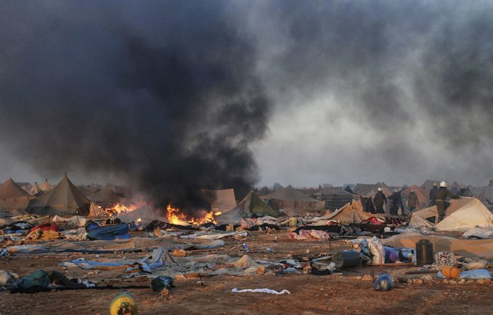 Cause: Moroccan forces destroy a camp near Western Sahara's capital