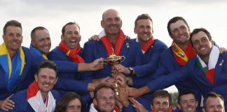 Team Europe players and captain Thomas Bjorn hold the trophy as they celebrate after winning the Ryder Cup.