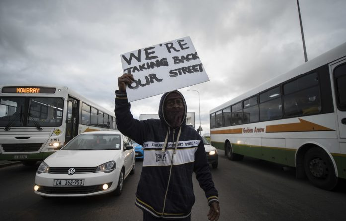 Rolling mass protests have swept through areas of the Cape Flats after Kensington and Factreton — an adjacent community — blocked Voortrekker Road to reclaim their streets from gangsters in August.