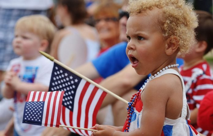 A girl watches the Independence Day parade in Takoma Park