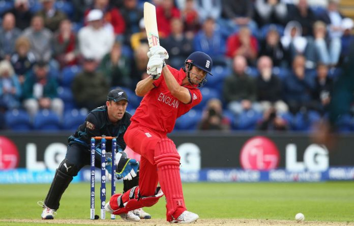 Alastair Cook of England hits straight as Luke Ronchi of New Zealand looks on from behind the stumps during the ICC Champions Trophy Group A match between England and New Zealand.