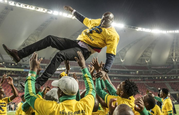 Yebo: Baroka FC players celebrate the Telkom Knockout win by throwing coach Wedson Nyirenda into the air.