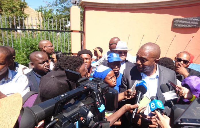 Mmusi Maimane speaks to journalists and residents in Sharpville on Human Rights Day.