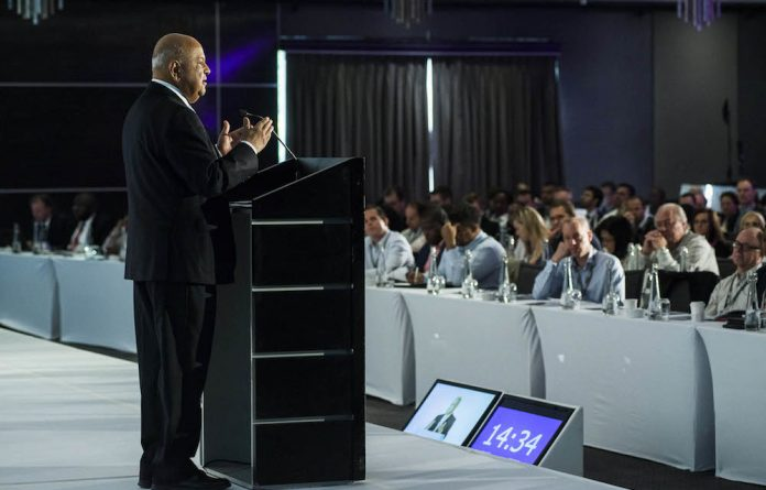 Finance minister Pravin Gordhan speaking in Johannesburg earlier this month. Gordhan said he saw more than 50% chance the country will avoid a downgrade by ratings agencies.