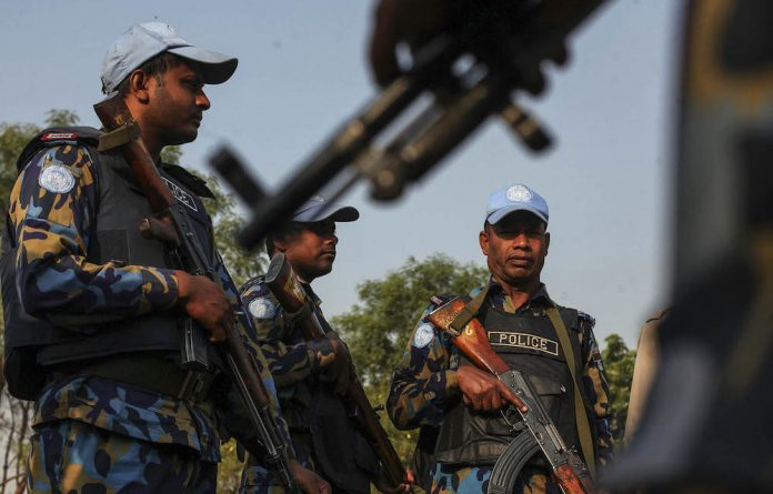 Danger zone: UN police officers patrol a camp for internally displaced persons in Juba