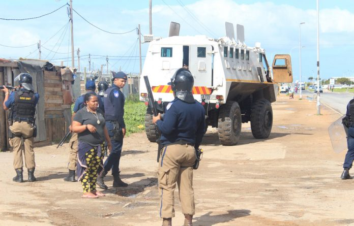 Metro police arrive to enforce evictions at Marikana settlement