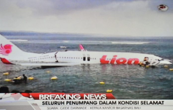 An airline spokesperson and government officials said the plane missed the runway and landed in shallow water.