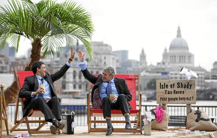 Deckchair activism: G8 protesters in London poke fun at tax-dodging corporates.