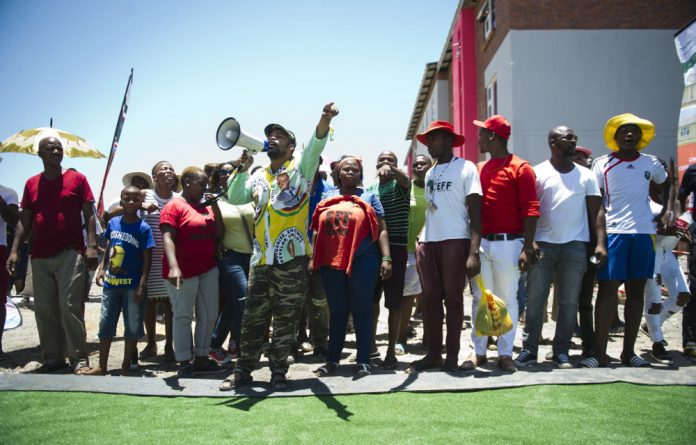 Speaking out: Napoleon Webster took part in housing protests in Marikana in 2016