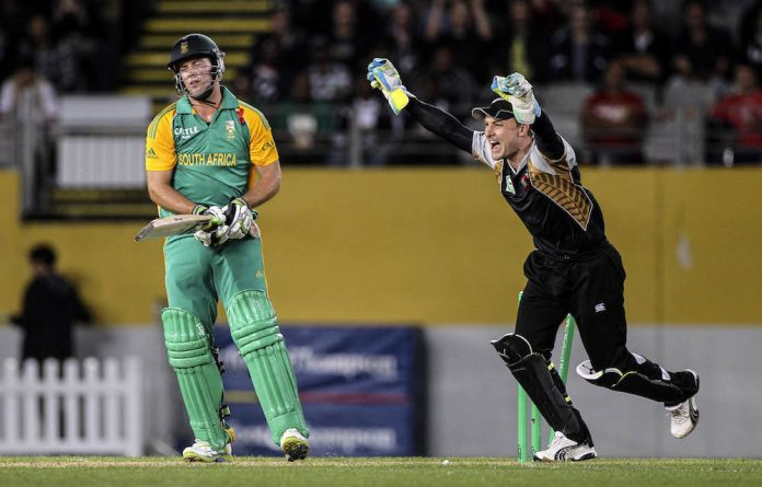 Bittersweet: New Zealand's Brendon McCullum celebrates after AB de Villiers is bowled for 29 during the T20 international match in Auckland on February 22 2012.