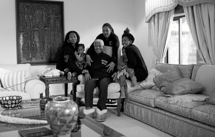 Reality show meets the real thing: Nelson Mandela is surrounded by his granddaughters Zaziwe Dlamini-Manaway