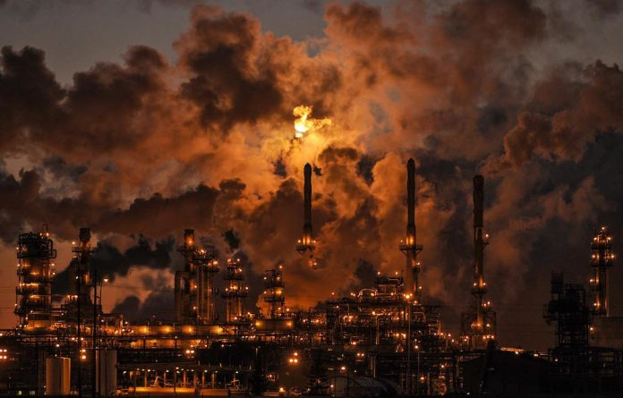 Petro-Canada's Edmonton Refinery and Distribution Centre glows at dusk. The G7 are making moves to cut the subsidies on fossil fuels in an effort to remain true to COP21.