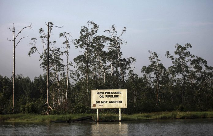 A Shell warning sign along Nembe creek in Nigeria's oil state of Bayelsa. The company is mired in a $1.1-billion bribery scandal in the oil-rich country. Photo: Akintunde Akinleye/Reuters