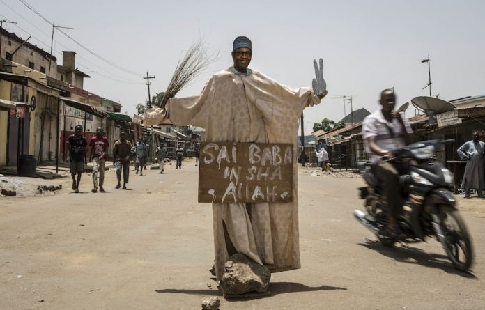 A makeshift figure of then-presidential candidate Muhammadu Buhari stands in an intersection in Kaduna in March 2015. Buhari won the election.