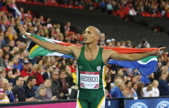 South African athlete Cornel Fredericks celebrates after winning the men's 400m hurdles at the 2014 Commonwealth Games in Glasgow