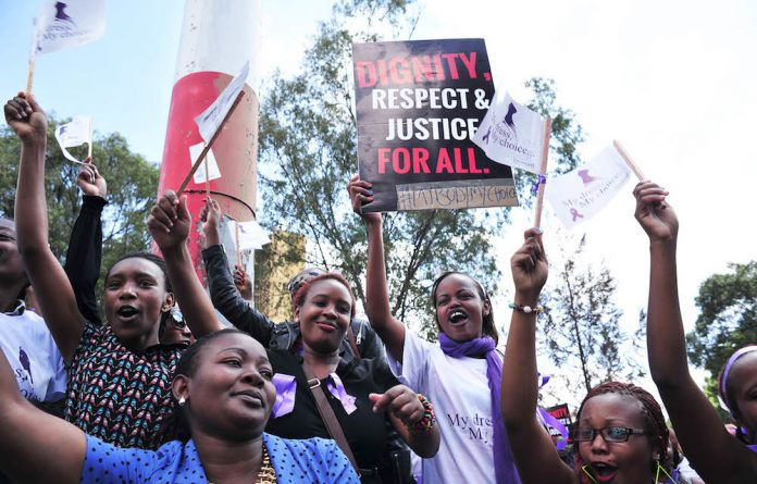Fighting back: Kenyans in Nairobi protest against violence inflicted on women.