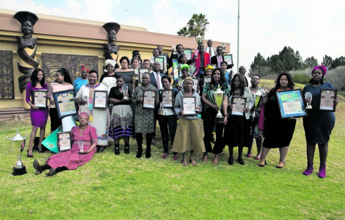 The winners of the annual Young Farmers and Young Female Entrepreneurs Awards with their various awards.