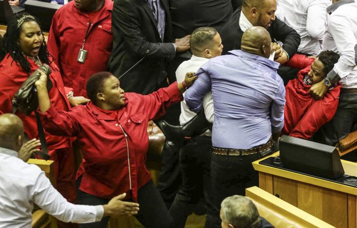 Mmabatho Mokause in action during the latest eviction of the EFF MPs from Parliament.