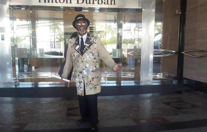 Obed Mbatha with his colourful jacket at the entrance to the Hilton Durban.