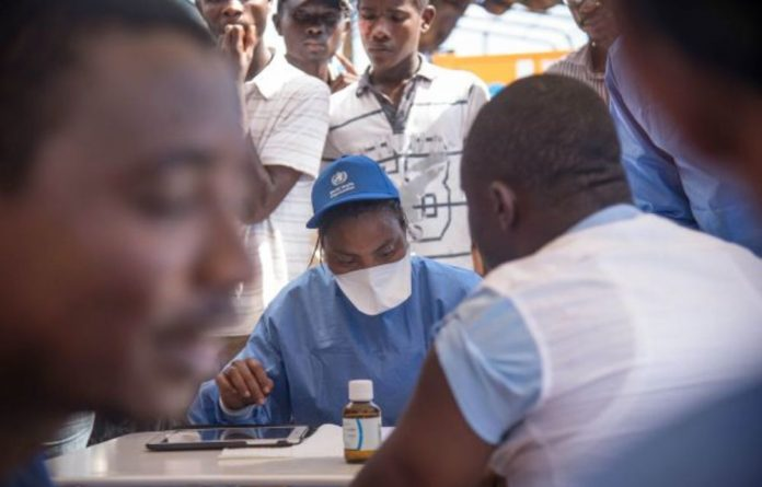 Nurses working with the World Health Organisation administer vaccines in Mbandaka.