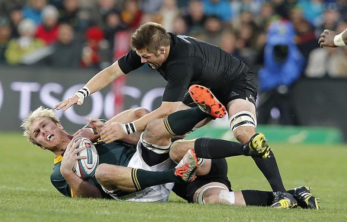 Richie McCaw scores despite a tackle by Jan Serfontein at the Westpac Stadium in Wellington on September 13.