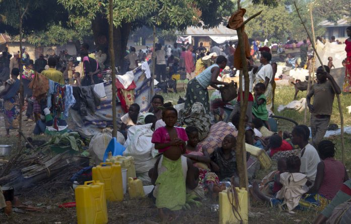 Refugees from eastern DRC wait at the Busunga border in western Uganda on July 13.