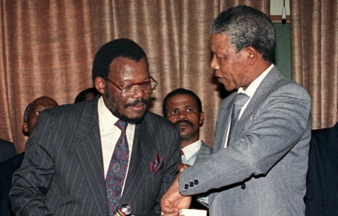 Inkatha Freedom Party leader Mangosuthu Buthelezi and Nelson Mandela.