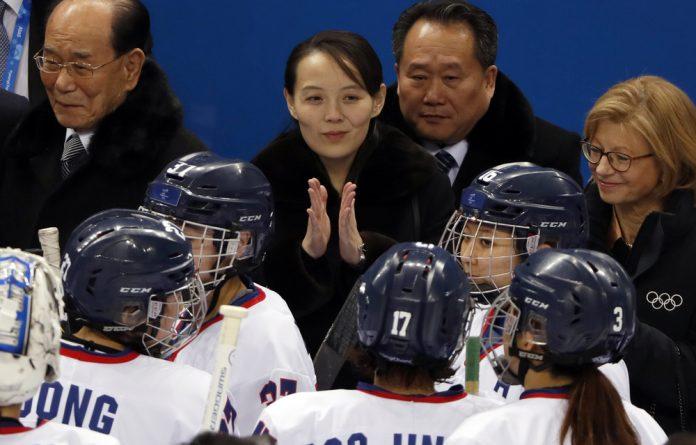Kim Yo Jong claps next to Kim Yong Nam at the women's preliminary ice-hockey match at the 2018 Winter Olympics