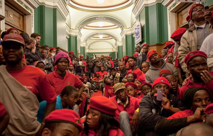 The EFF forced their way into the Gauteng legislature – while the house was debating issues without them.