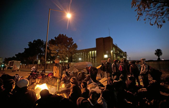 The forgotten: Immigrants sometimes camp outside home affairs offices in ­Pretoria for days in order to get residency permits.