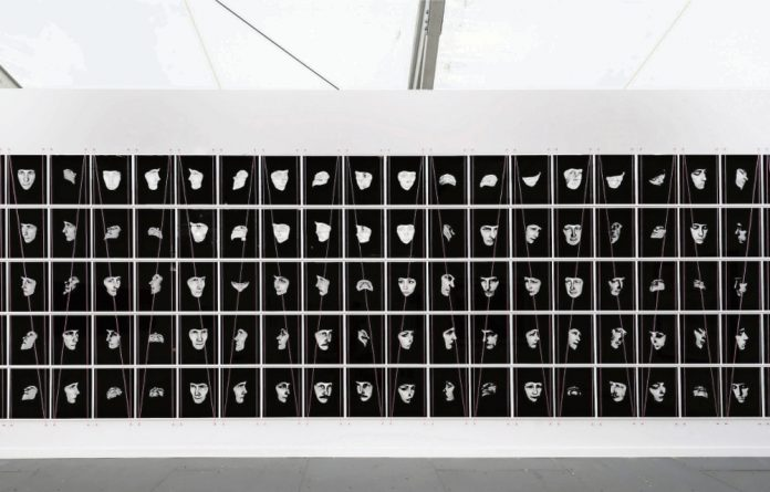 Portrait power: Detail from Adam Broomberg and Oliver Chanarin's work 'Shtik Fleisch mit Tzvei Eigen' that explores the role of photography in state surveillance.