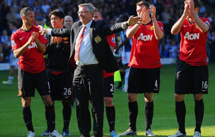 Manchester United manager Sir Alex Ferguson is applauded by players after his 1 500th and final match in charge of the club following the Barclays Premier League match between West Bromwich Albion and Manchester United.