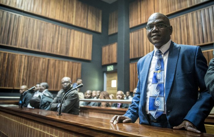 Former crime intelligence boss Richard Mdluli appeared in court in 2014 for the murder of his ex-girlfriend's husband.