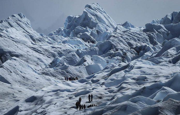 Hikers atop Perito Moreno glacier in Argentina's Los Glaciares National Park