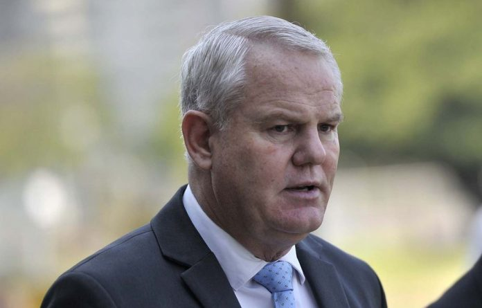 The state has withdrawn charges against two men accused of trying to bribe the Hawks's Johan Booysen.