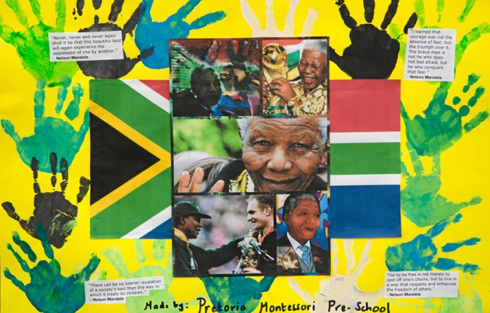 One of the many tributes to Nelson Mandela - a poster from Pretoria Montessori Preschool - adorns a wall outside the Mediclinic Heart Hospital in the capital.