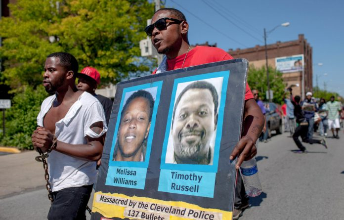 Protesting: African-Americans demonstrated when a Cleveland police officer was acquitted of manslaughter after he shot Melissa Williams and Timothy Russell in 2012 following a high-speed car chase. Photo: Ricky Rhodes/Getty Images/AFP