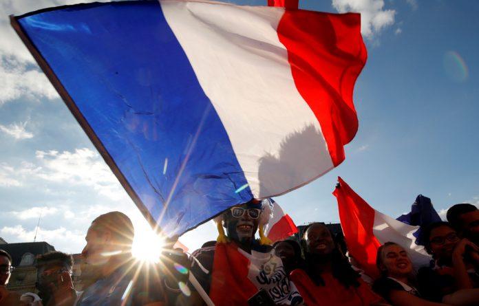 Fans react in a fan zone at the Hotel de Ville.