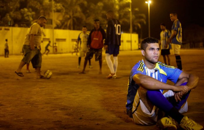 Youngsters from a slum in Sao Paulo have thrown down a World Cup gauntlet: they have challenged the winners to play a match against them.