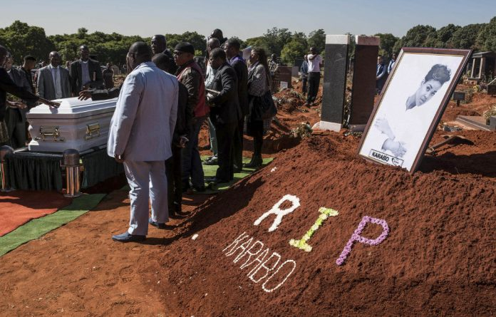 Death of a beauty: Karabo Mokoena's burial at the Westpark Cemetery in Johannesburg on May 19. Much of the public outrage over her murder centred on her looks.