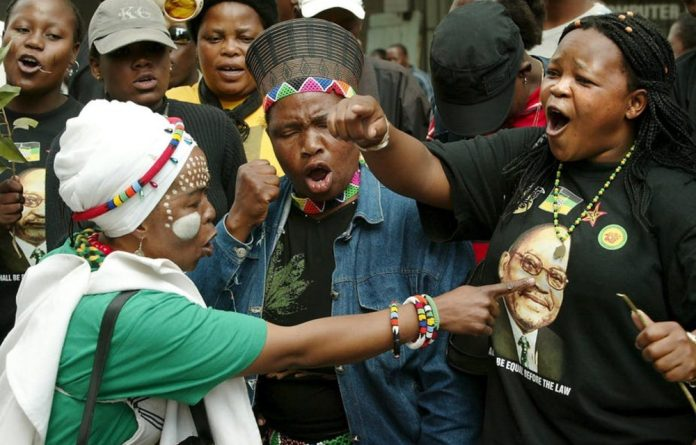 Supporters of President Jacob Zuma in full cry outside the court during his 2006 rape trial.