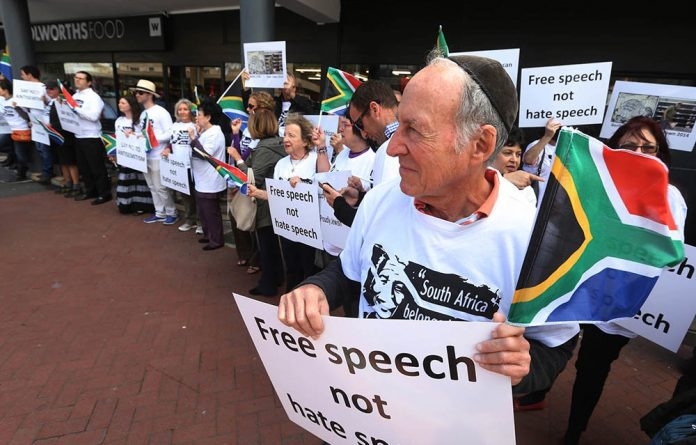 Members of the Jewish community picket outside the Woolworths in Sea Point