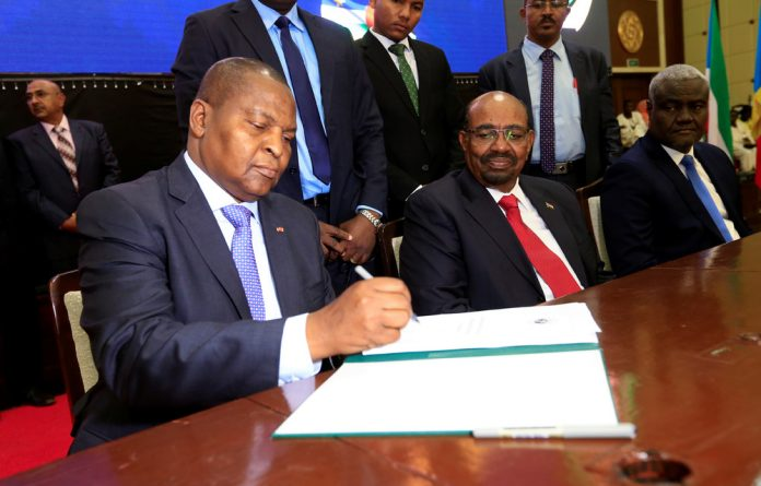 President Faustin Archange Touadera signs a peace deal between the Central African Republic government and 14 armed groups following two weeks of talks in the Sudanese capital Khartoum.